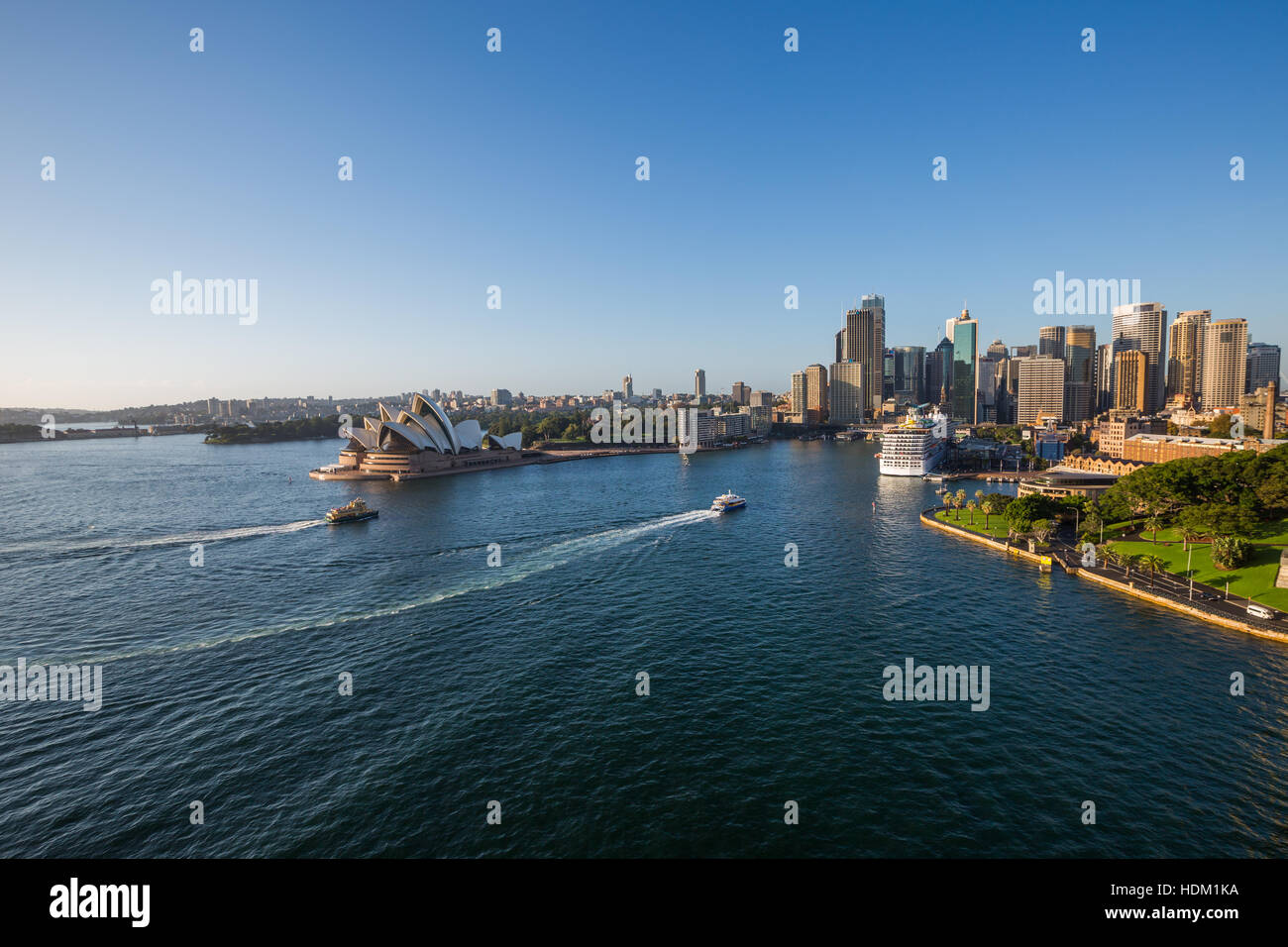 View of Sydney Harbour, the Opera House and the CBD from the bridge. - Stock Image
