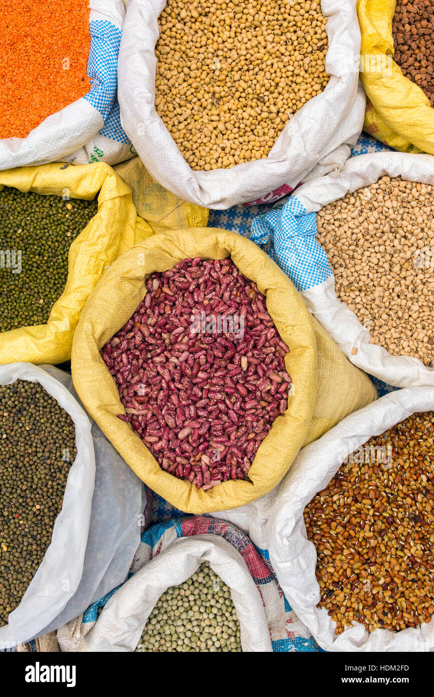 Sacks with Legumes Beans on the Market. Top view Stock Photo
