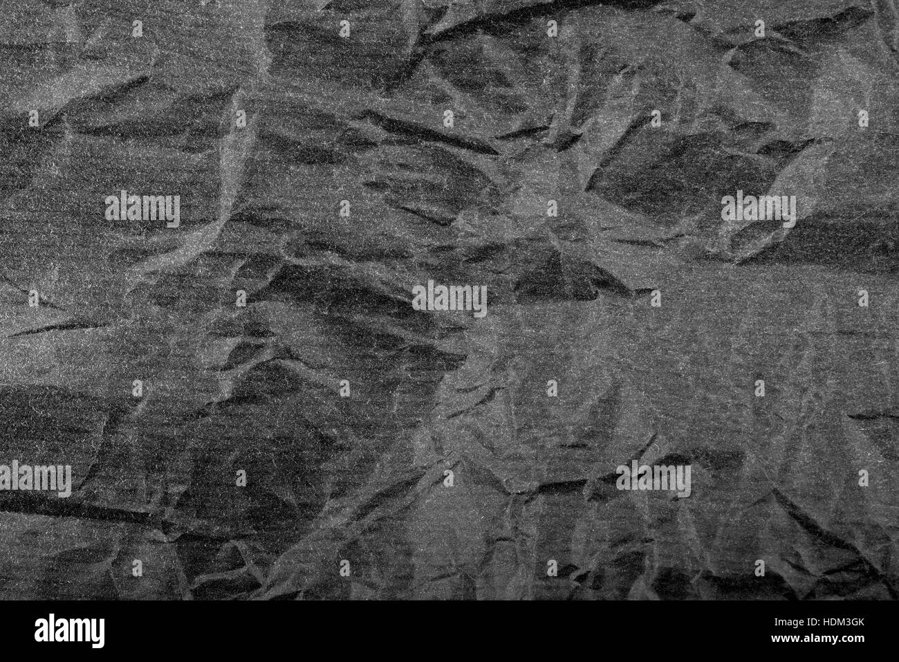 crumpled black paper,Black background - Stock Image