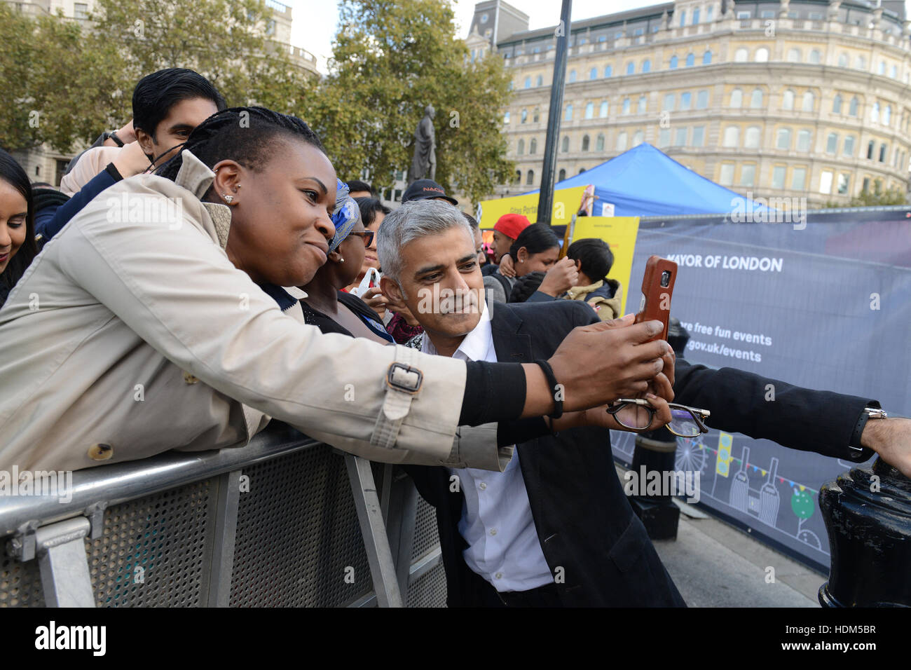 London Mayor Sadiq Khan is seen taking selfies in Trafalgar Square as it hosts 'Africa on the Square' to celebrate - Stock Image