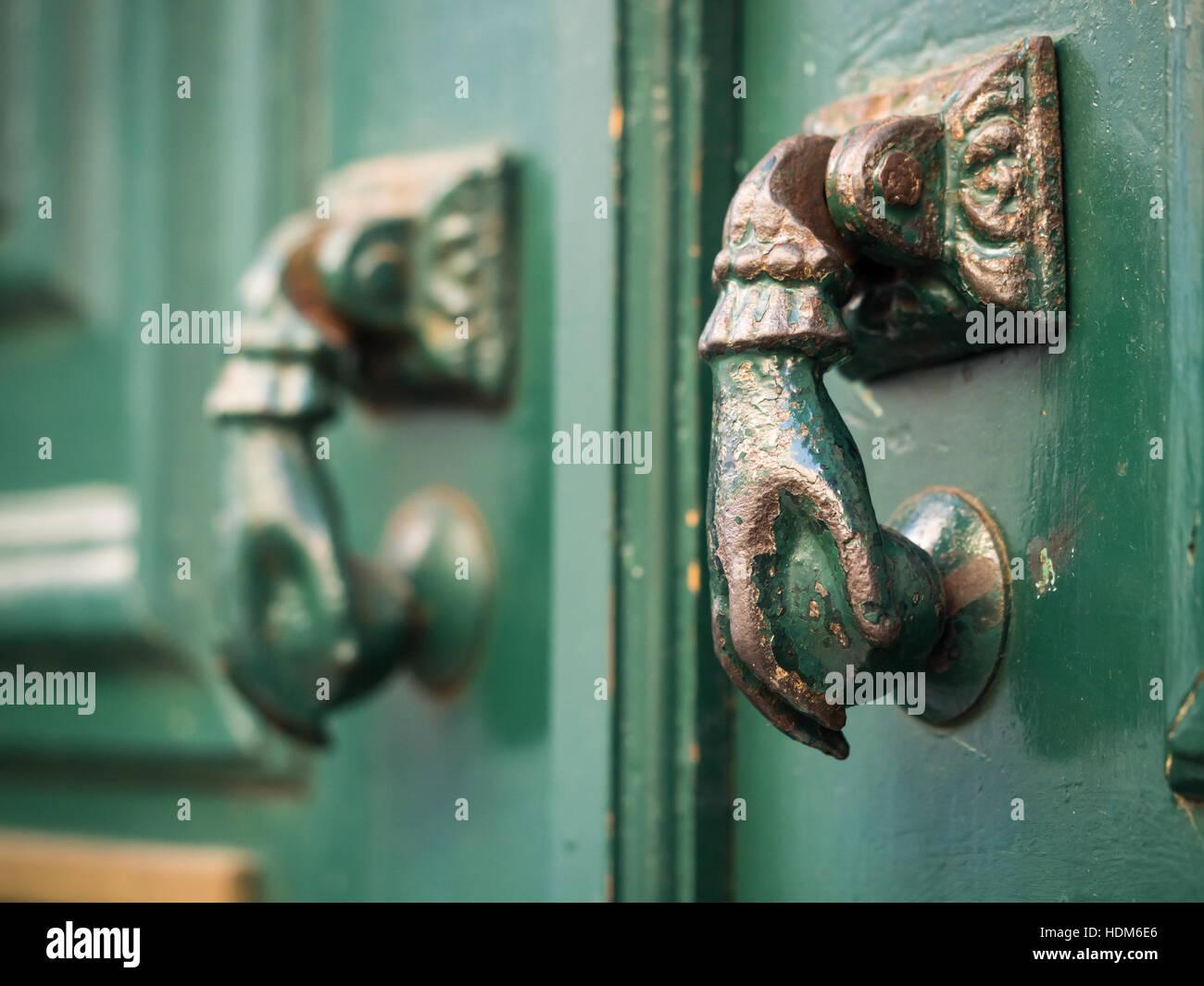 Old hand shaped metal door handles in Bairro Alto, Lisbon, Portugal - Stock Image