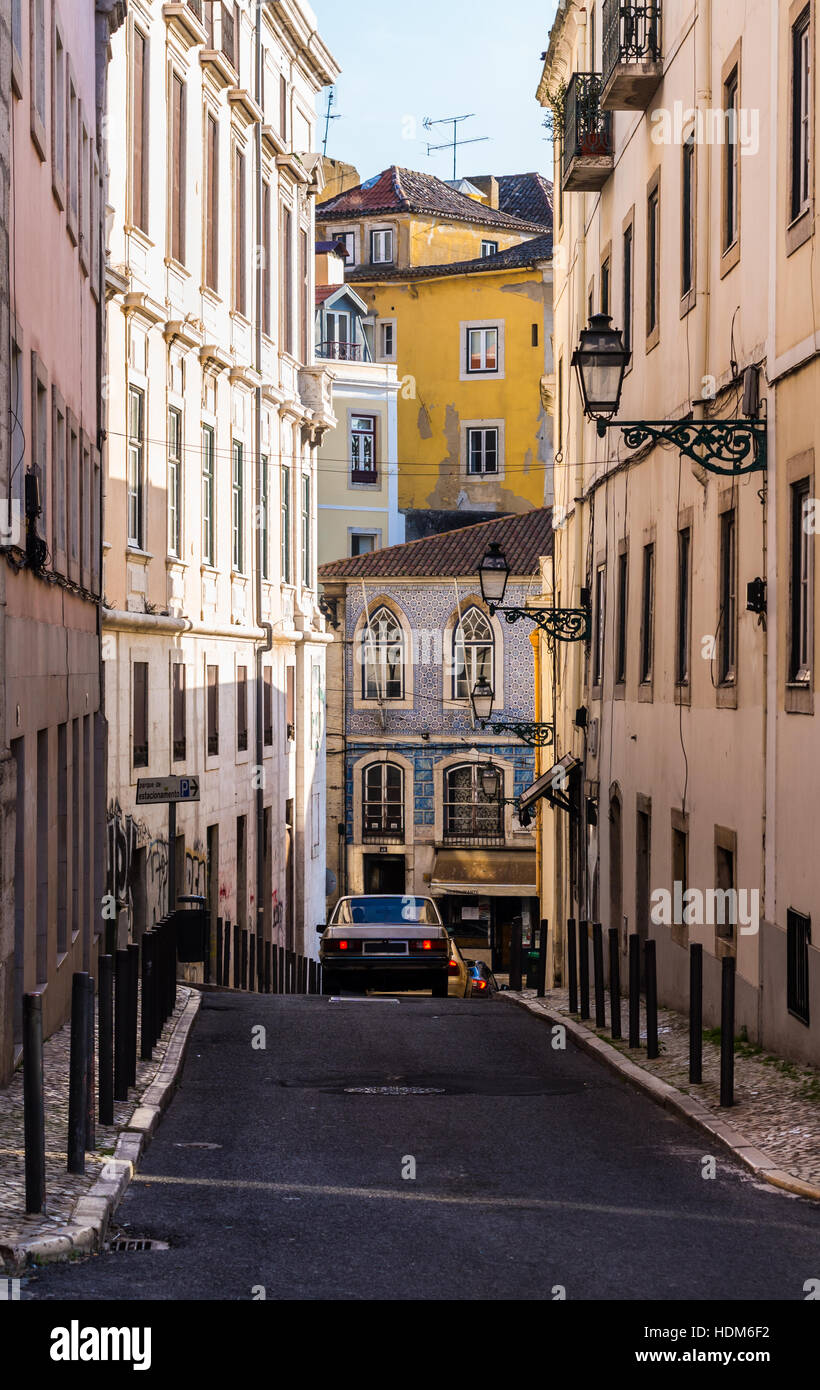One of the narrow streets in the Old Town of Lisbon, Portugal. - Stock Image