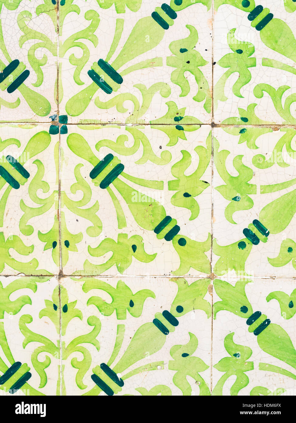 Green azulejos, old tiles in the Old Town of Lisbon, Portugal, close up. - Stock Image