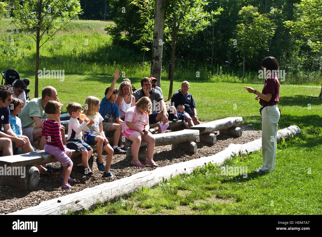 Vermont Institute of Natural Sciences, Quechee, Vermont, USA. Adults and children attending a demonstration at VINS - Stock Image