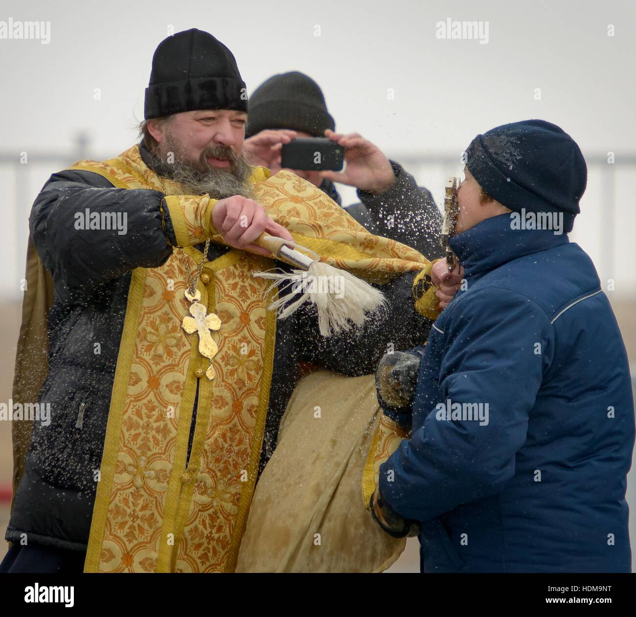A Russian Orthodox Priest blesses a NASA International Space Station Expedition 50 mission crew member after blessing - Stock Image