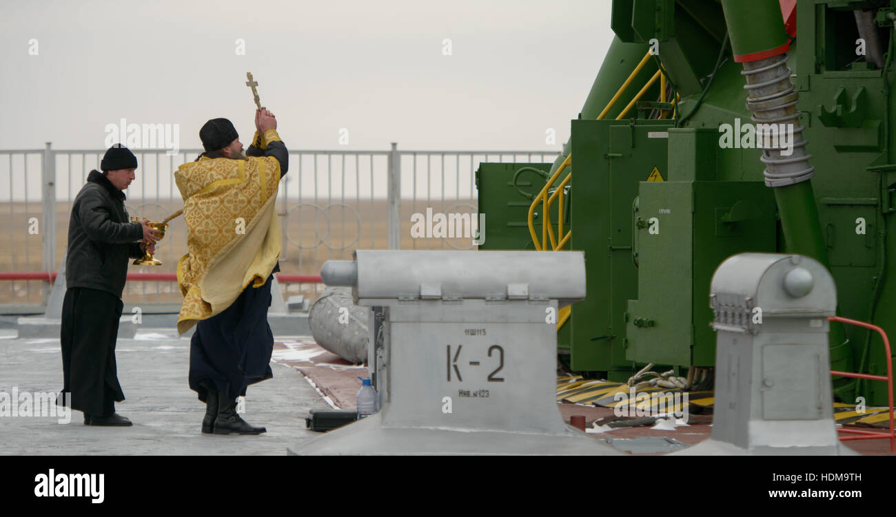 A Russian Orthodox Priest blesses the Soyuz MS-03 spacecraft rocket at the Baikonur Cosmodrome launch pad in preparation - Stock Image