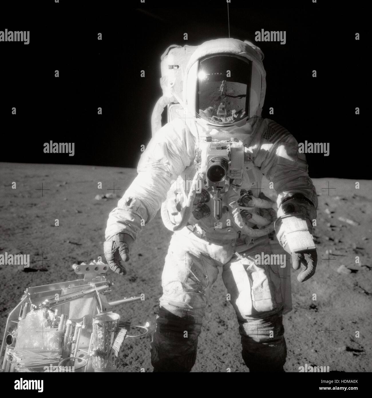 NASA Apollo 12 lunar landing mission astronaut Alan Bean pauses near a tool carrier during an EVA spacewalk November - Stock Image