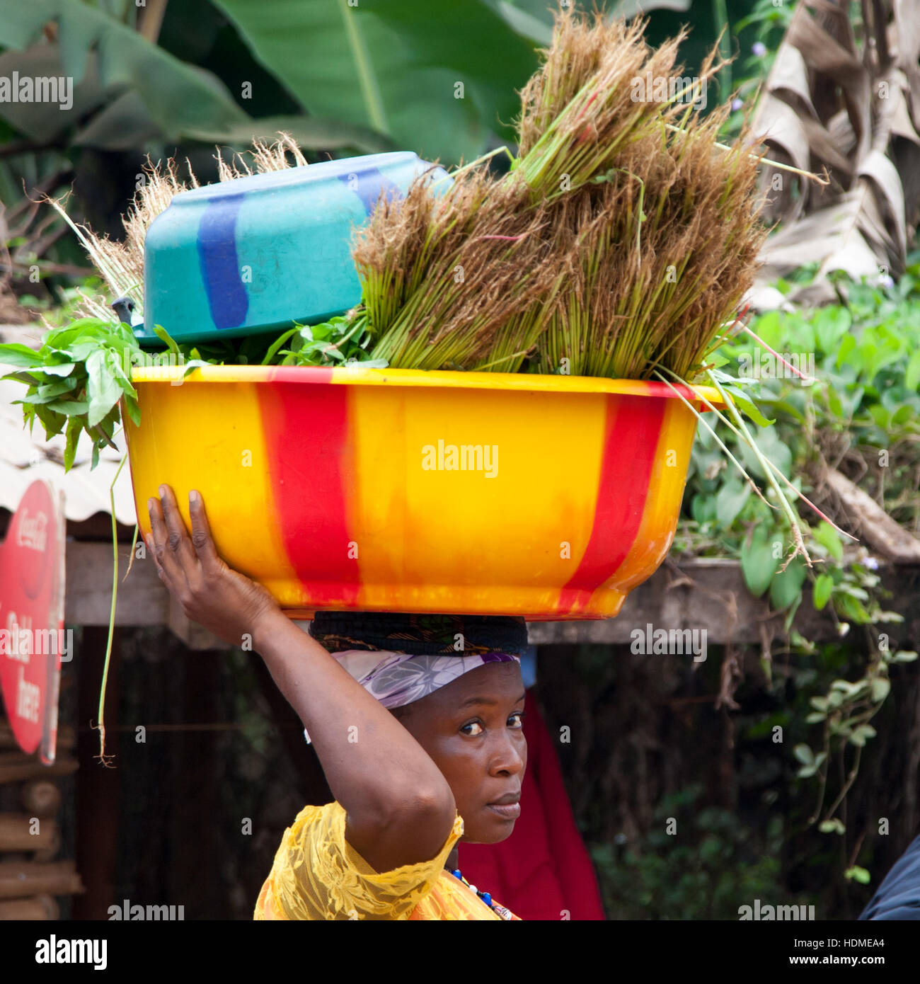 African woman carrying vegetables on her head Stock Photo