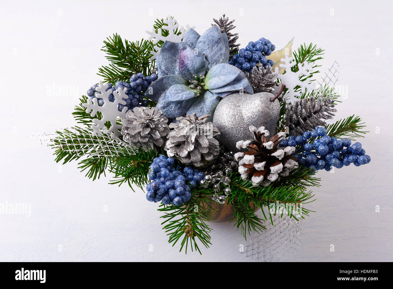 Christmas greenery with silver glitter decor and blue silk stock christmas greenery with silver glitter decor and blue silk poinsettias artificial christmas flower arrangement with pine cones and fir branches chri mightylinksfo