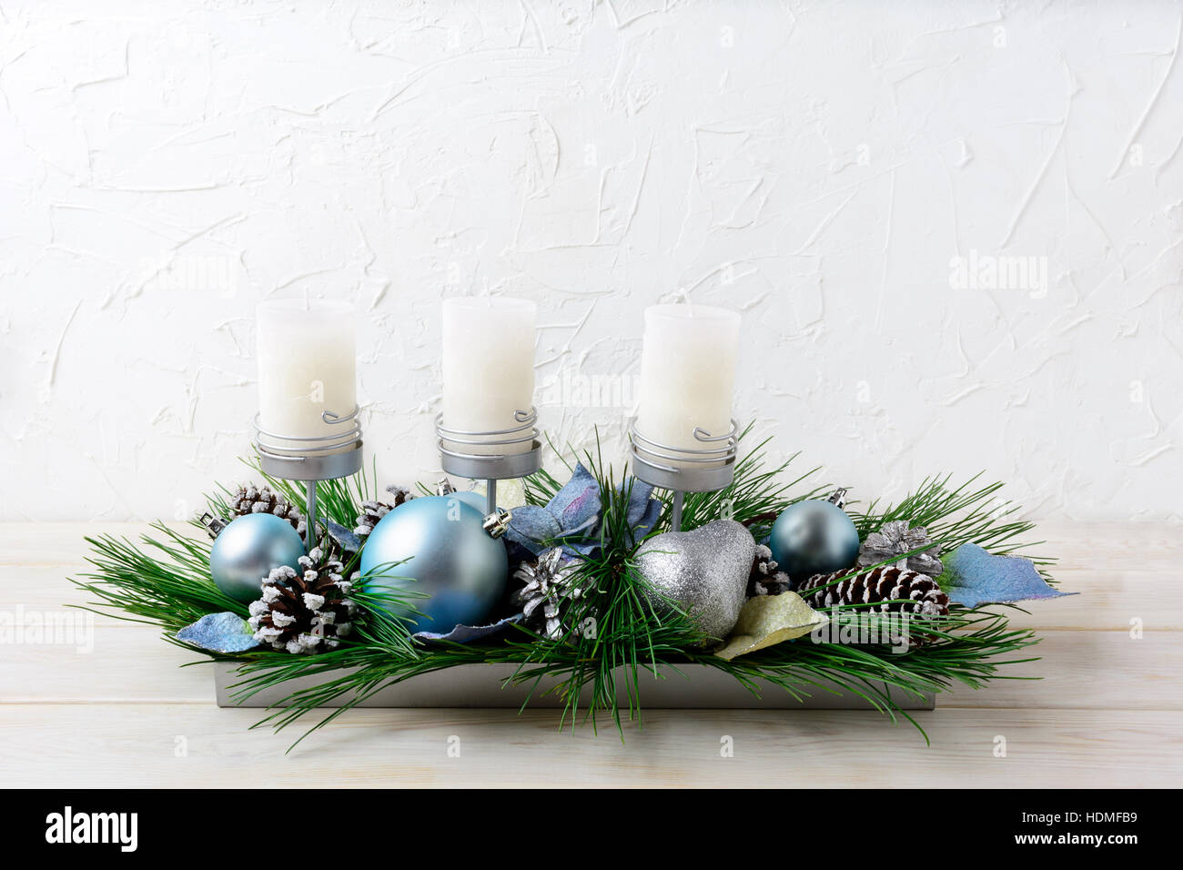 Christmas Table Centerpiece With Three Candles And Blue Ornaments