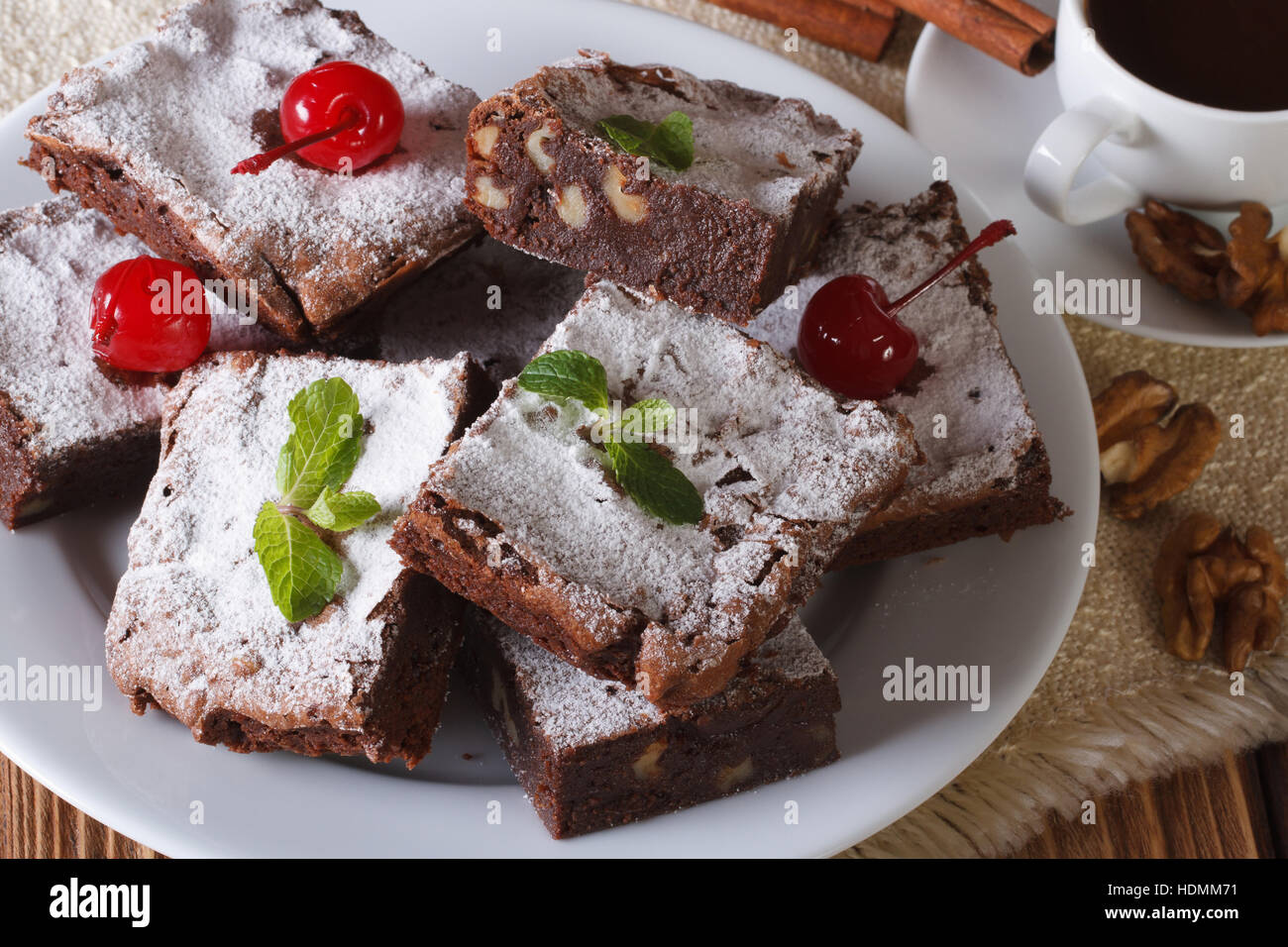 chocolate cake brownie with walnuts and coffee. Horizontal close-up Stock Photo