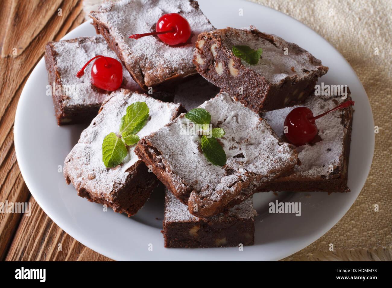 chocolate cake brownie with walnuts and cherries close-up. horizontal - Stock Image