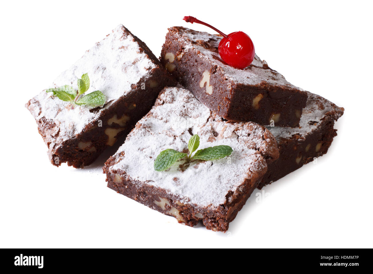 chocolate cake brownie with walnuts and cherries close-up. horizontal isolated on white background - Stock Image