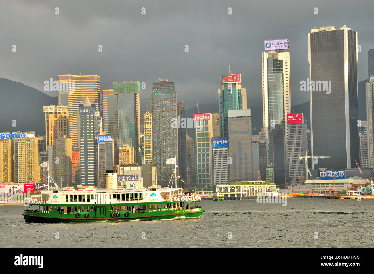 Star Ferry crossing Victoria Harbour between Kowloon and Hong Kong Island Stock Photo