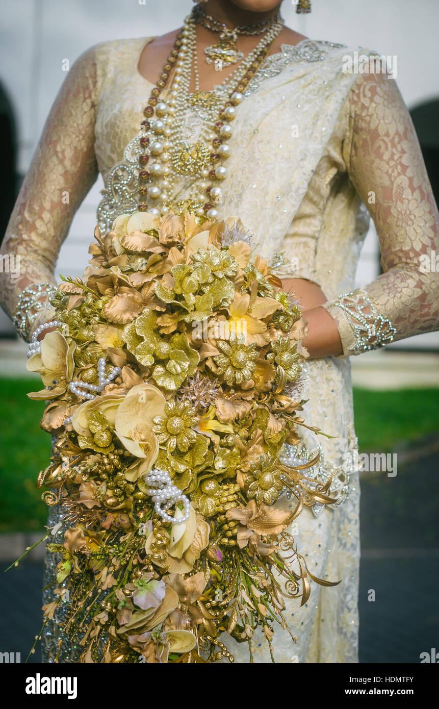 Sri lankan wedding stock photos sri lankan wedding stock images sri lankan bride with a wedding bouquet stock image izmirmasajfo