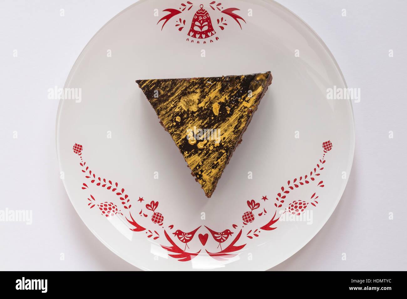 M&S Christmas Chocolate & Mandarin Desserts - mandarin dessert on festive plate Stock Photo