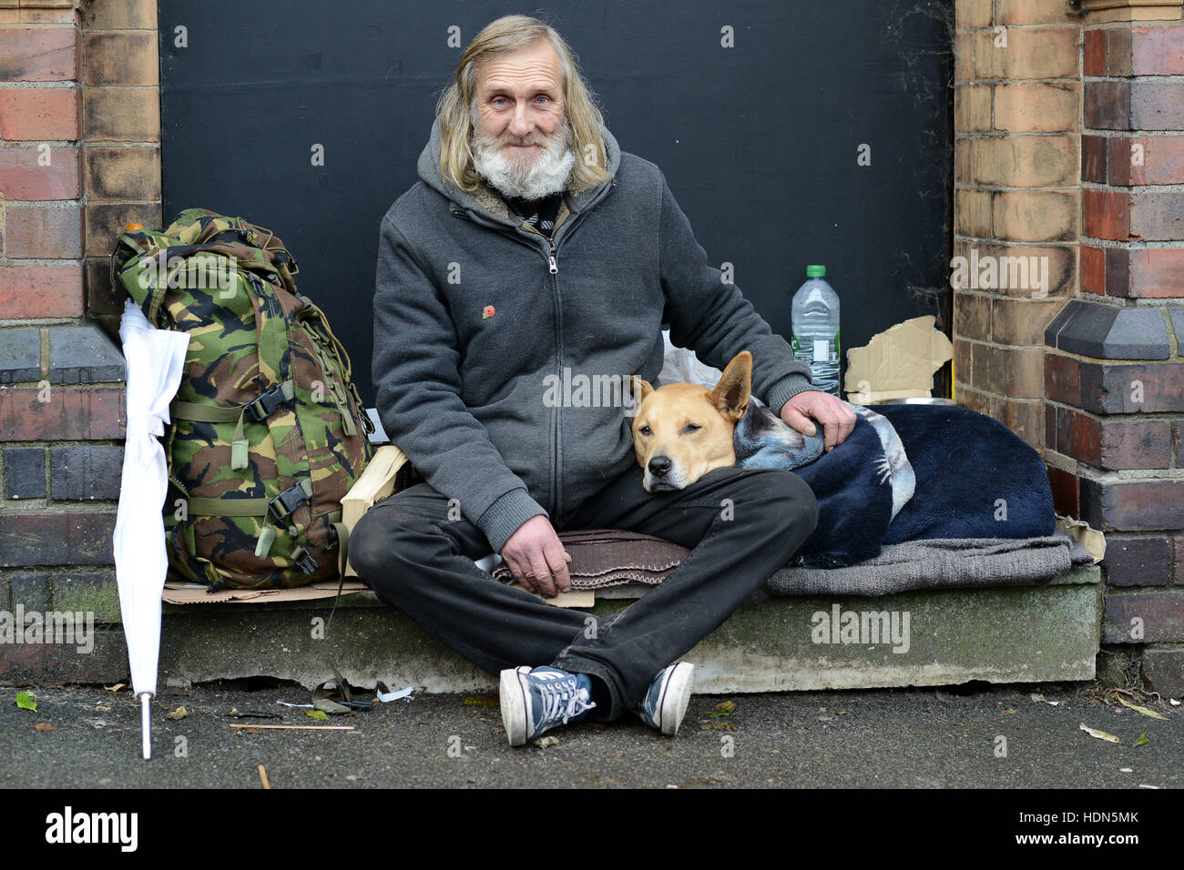 A homeless man and his canine companion living rough on the streets of Birmingham. The pair have been together 10 - Stock Image