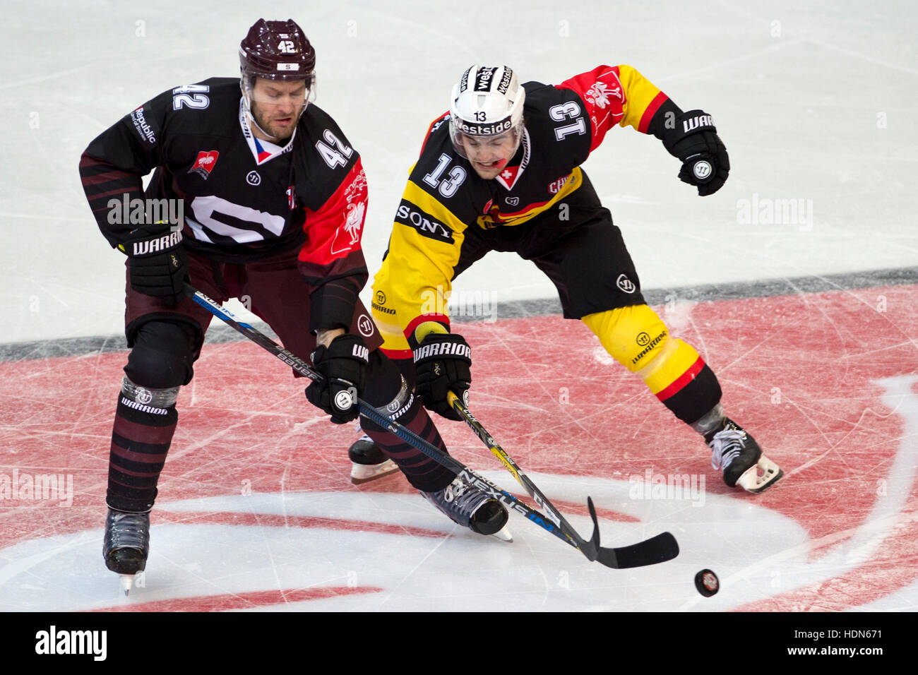 Prague, Czech Republic. 13th Dec, 2016. From left: Michal Barinka of Sparta and Luca Hischier of Bern in action Stock Photo
