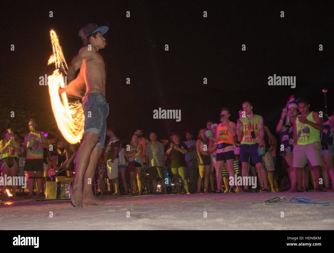 A display of fire dancing at a Full Moon party on Sunrise beach Haad Rin on the island of Kho Phag Nang Thailand - Stock Image