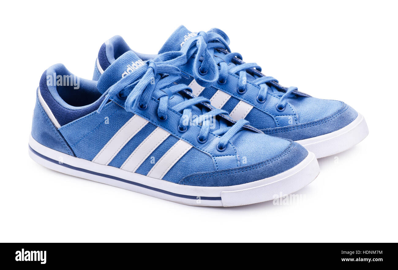 SAMARA, RUSSIA - October 5, 2016: Adidas Neo sneakers for running, football, training, in white and blue, showing - Stock Image