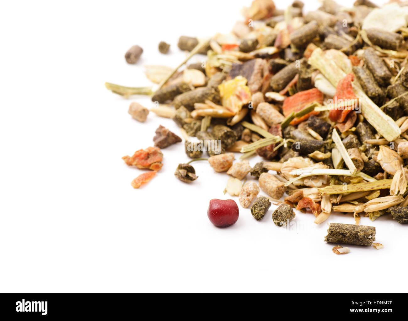Close-up rodents food mix isolated on a white background - Stock Image