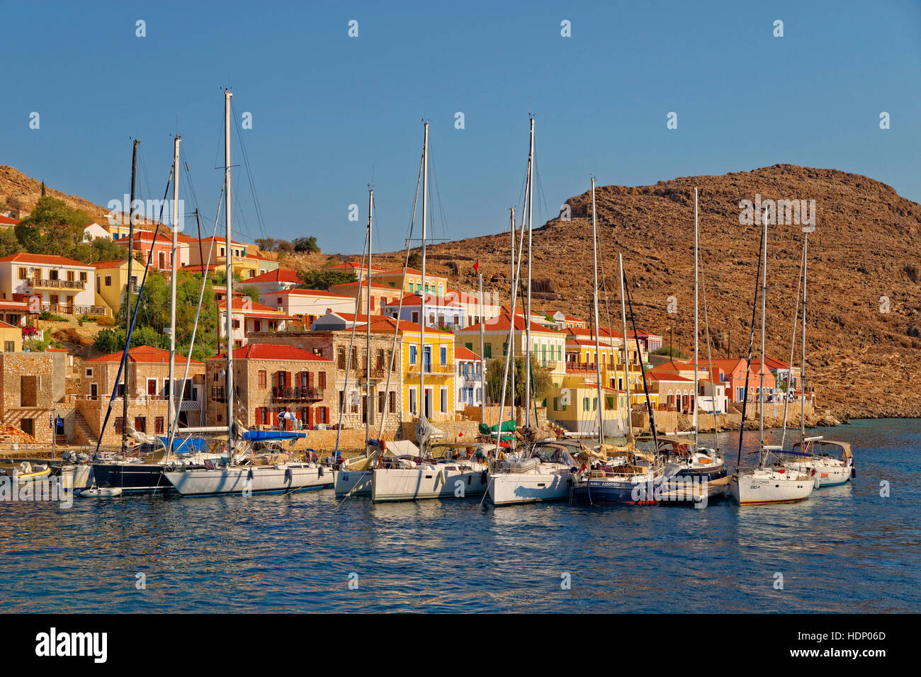 Yacht berths at Chalki town, Greek island of Chalki situated off the north coast of Rhodes, Dodecanese Island group, Stock Photo