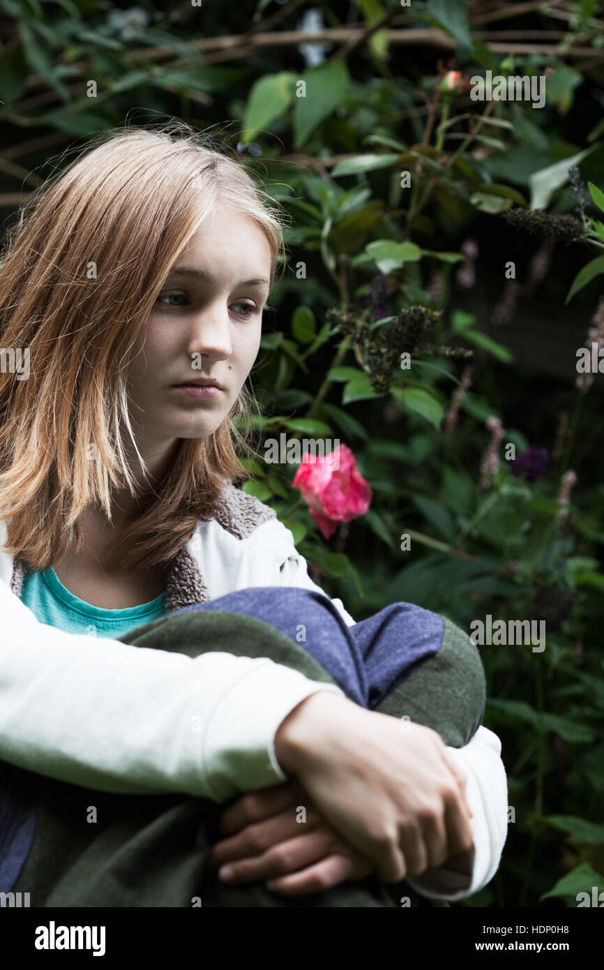 Sad and vulnerable girl - Stock Image