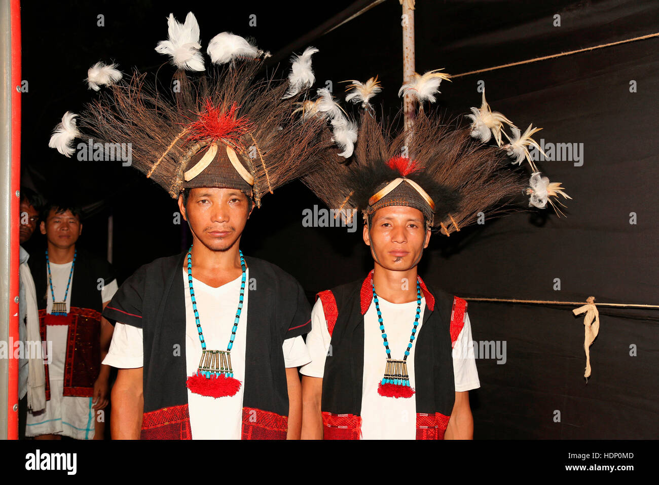Adi Tribal Men with Traditional Headgear from Arunachal Pradesh India. Tribal Festival in Ajmer, Rajasthan, India - Stock Image