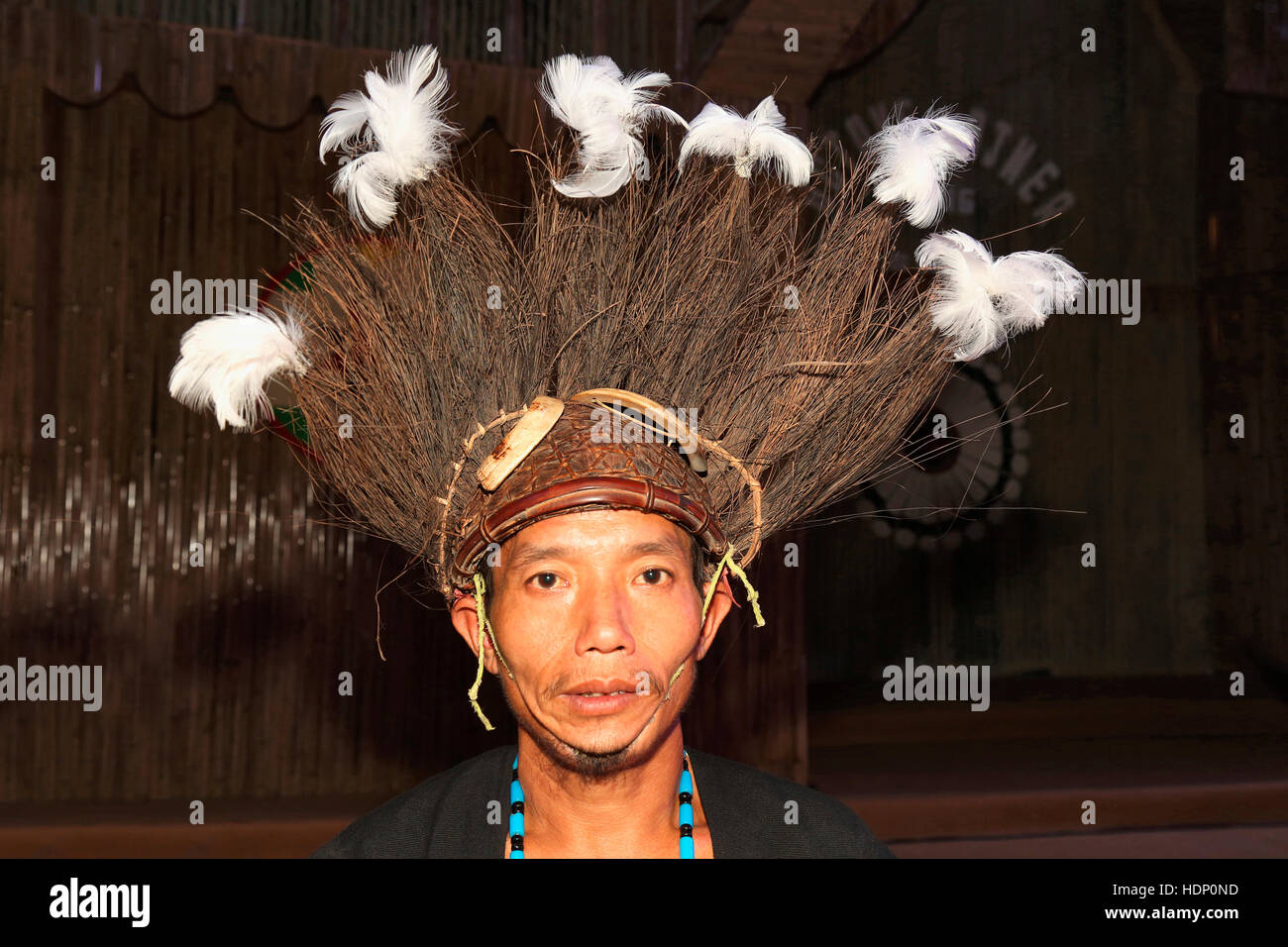 Adi Tribal Man with Traditional Headgear from Arunachal Pradesh India. Tribal Festival in Ajmer, Rajasthan, India - Stock Image
