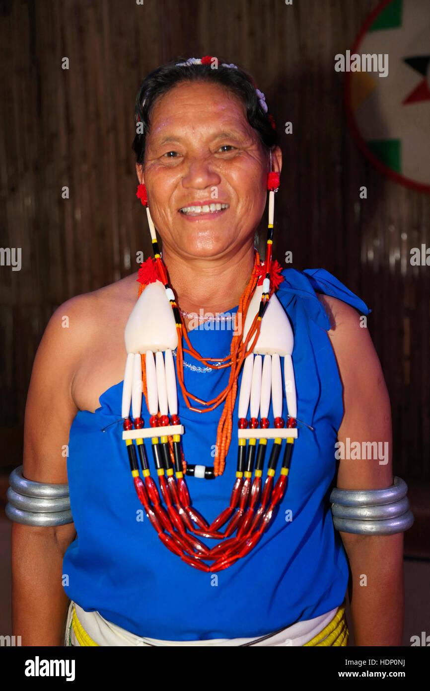 Rengma Tribal woman wearing traditional jewelry Takfuton Necklace , Akwie ( Arm Bangles ) , Ayeikhoa Headgear , - Stock Image