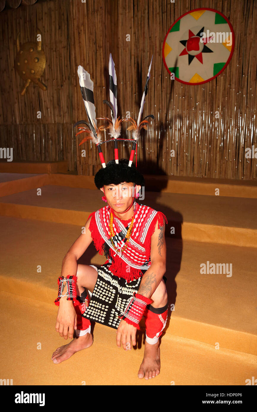 Rengma Tribal Man From Nagaland Sitting - He is Wearing Awachu Nu Headgear. - Stock Image