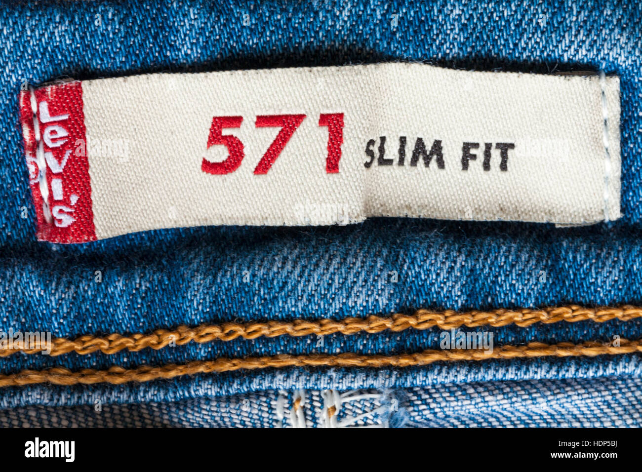 Levis 571 slim fit label in denim jeans - Stock Image