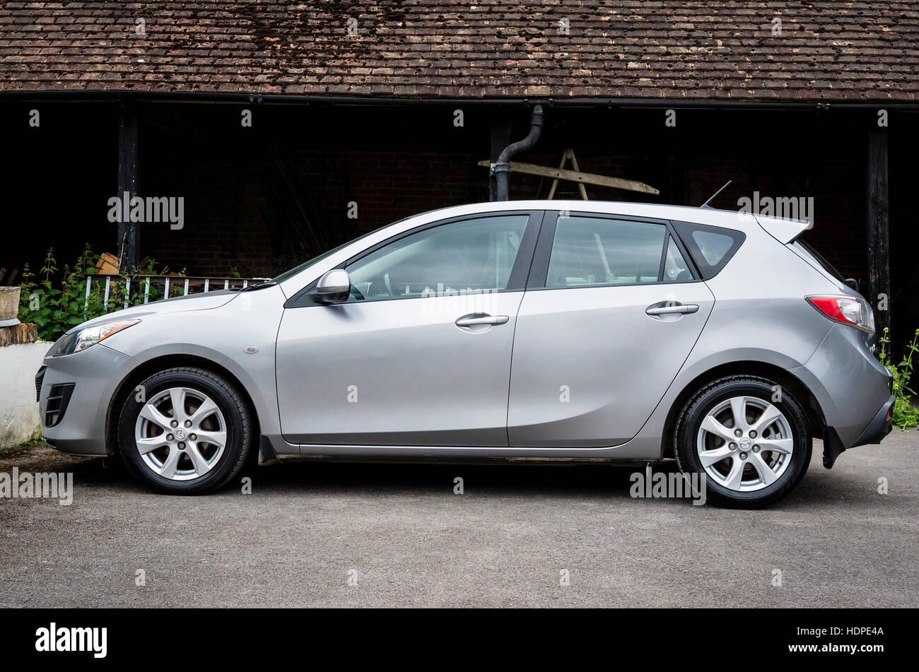 Mazda 3 hatchback saloon in England  UK - Stock Image