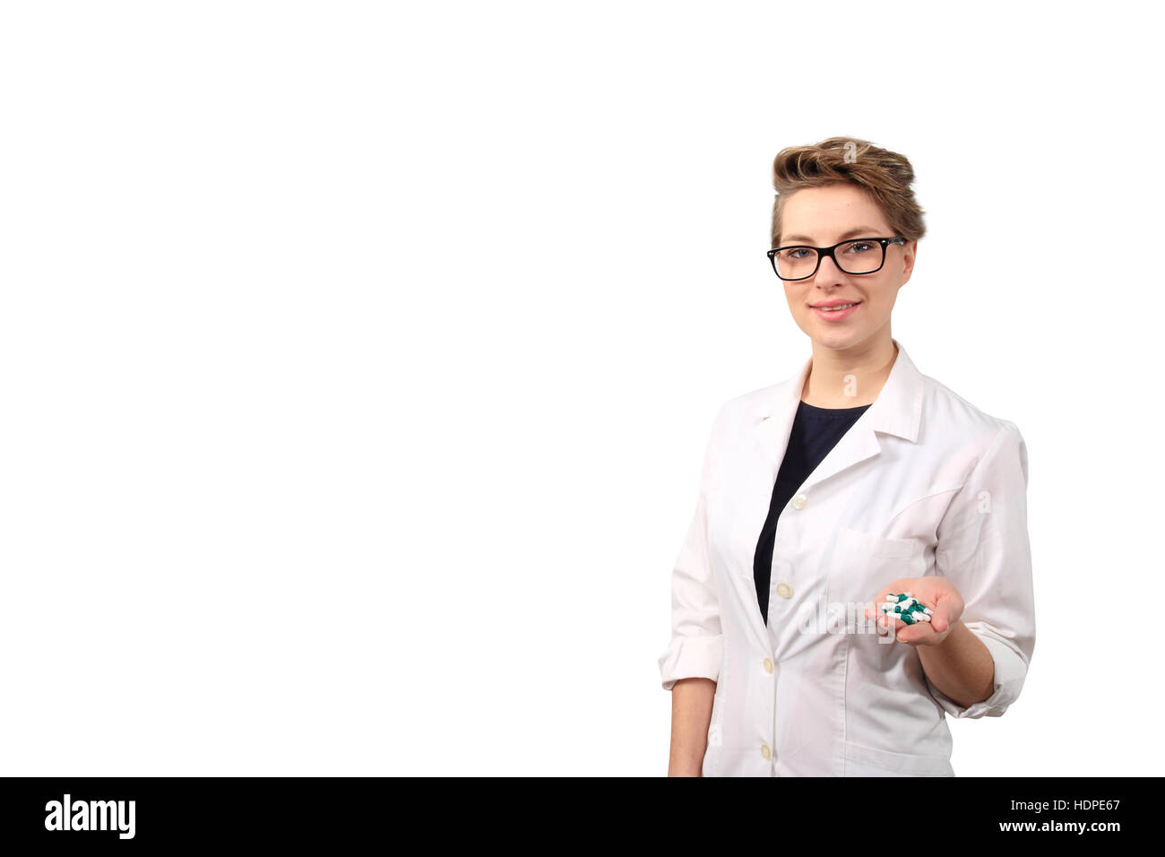 young female pharmacist holding medicine pills - Stock Image