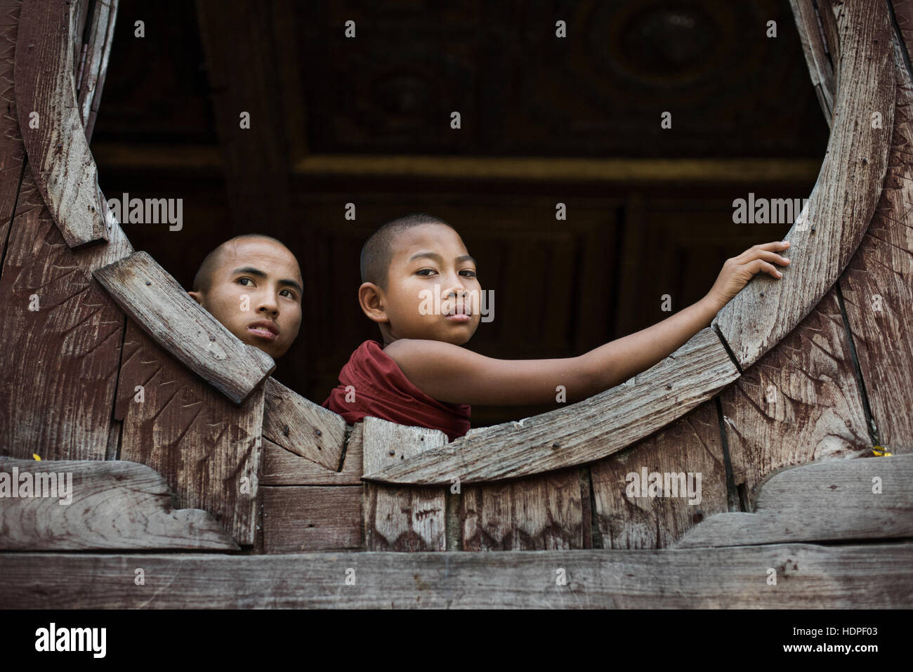 Novice Buddhist monks at Shwe Yan Pyay Wooden Monastery in Nyaungshwe, Myanmar. - Stock Image