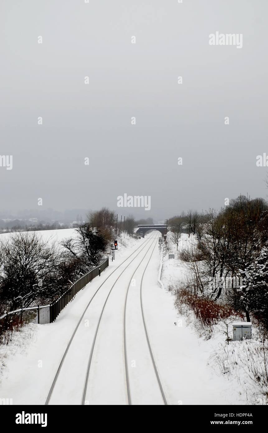 Railway lines in snow - Stock Image