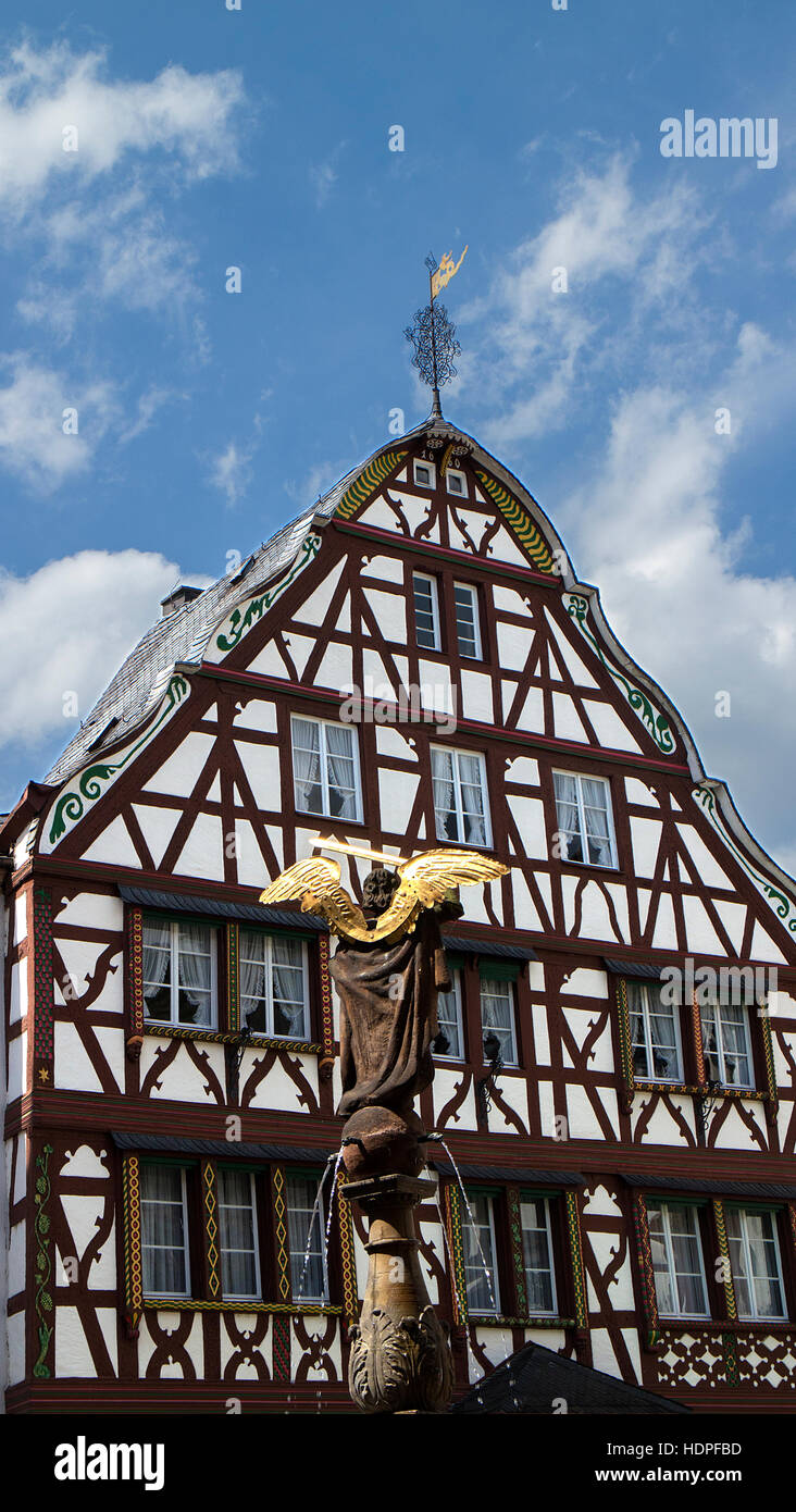 Half-timbered building and Angel statue,Marktplatz square, Bernkastel-Kues, Moselle Valley, Rhineland-Paltinate, - Stock Image