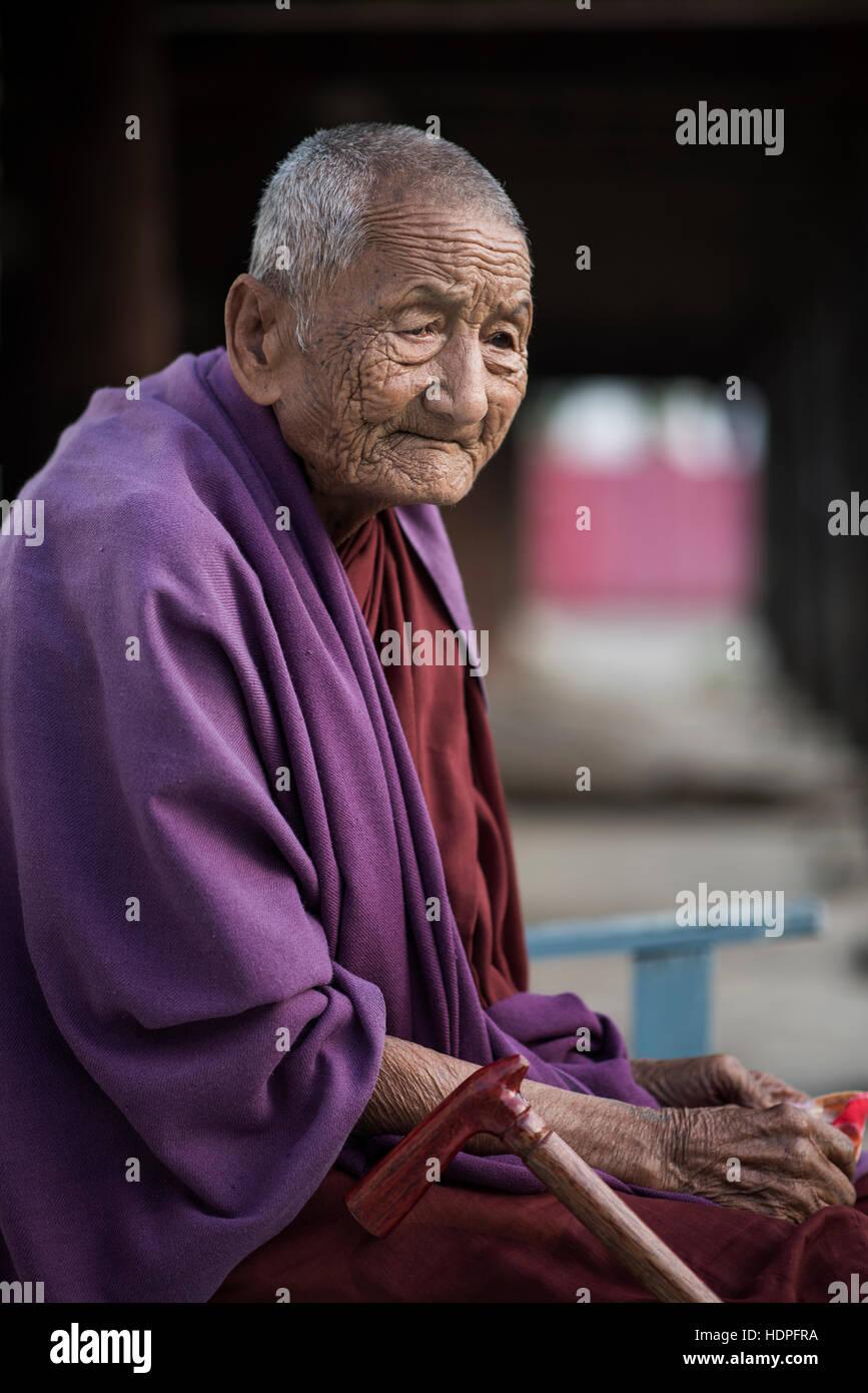 Portrait of an elder Buddhist monk, Shwe Yan Pyay Monastery, Nyaungshwe, Myanmar. - Stock Image