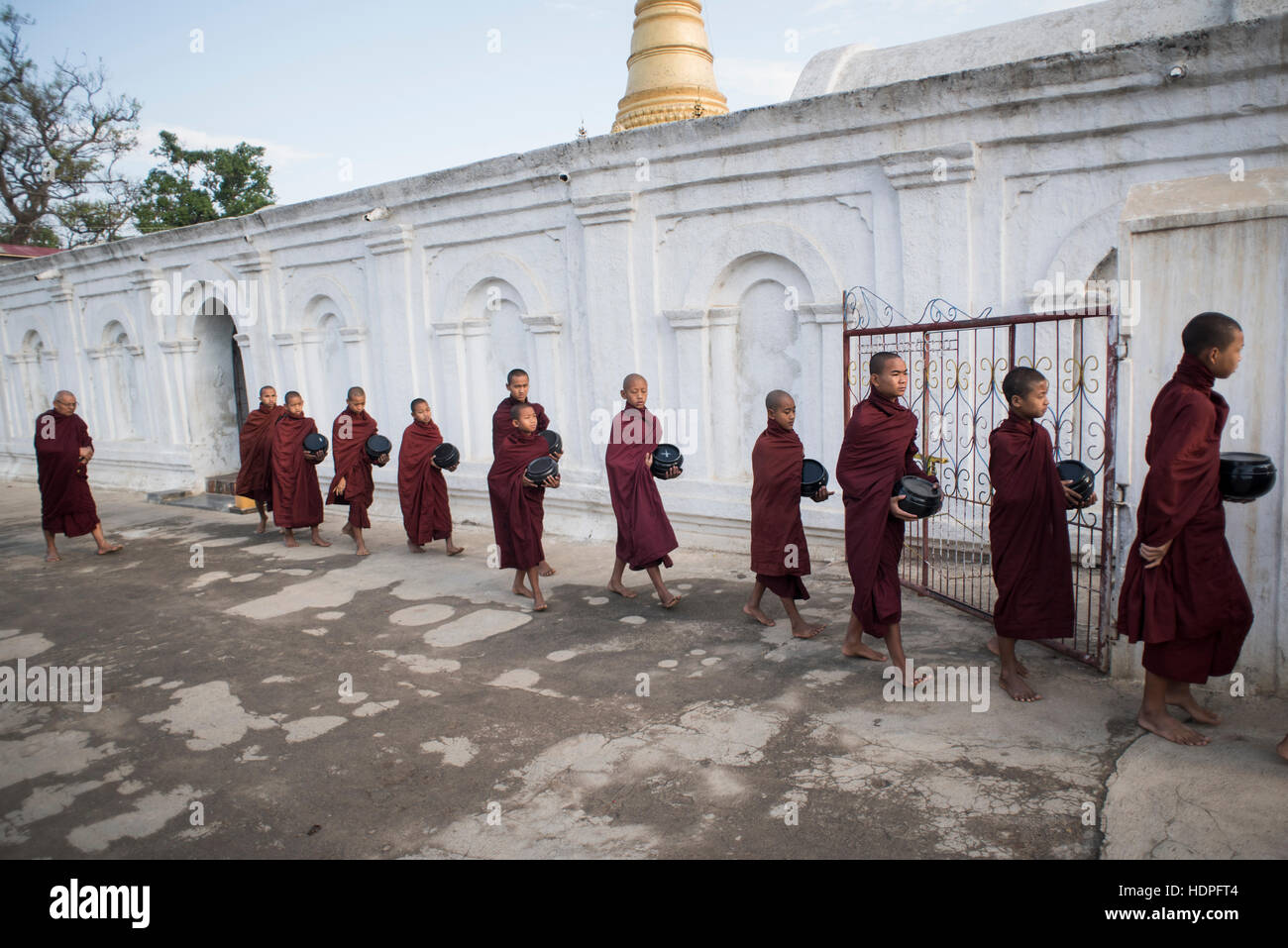 A group of young Buddhist monks prepared to go the morning food alms collection,  Shwe Yan Pyay Monastery, Nyaungshwe, - Stock Image