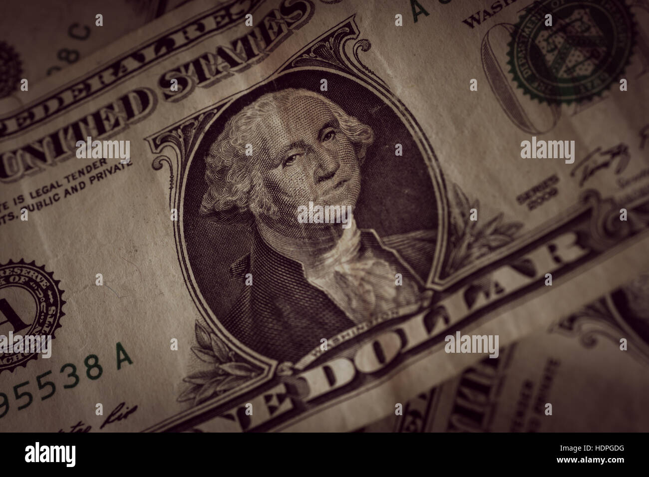 Old and crumpled United States one dollar bank notes photographed with shallow focus and an antique filter applied Stock Photo