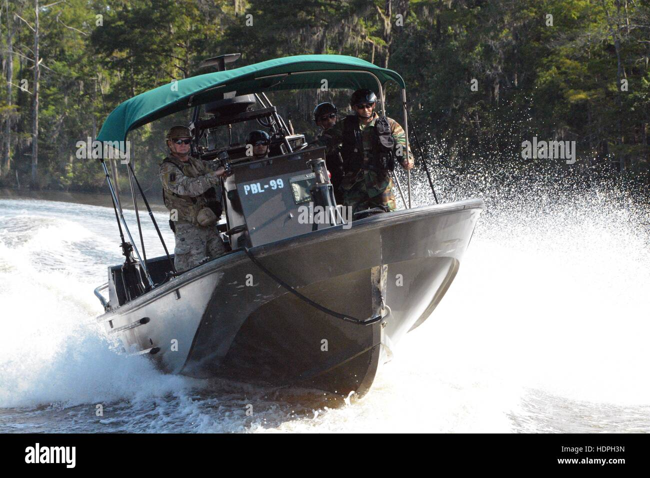 International special operation soldiers practice high-speed maneuvers on Pearl River during the Waterborne Instructor - Stock Image