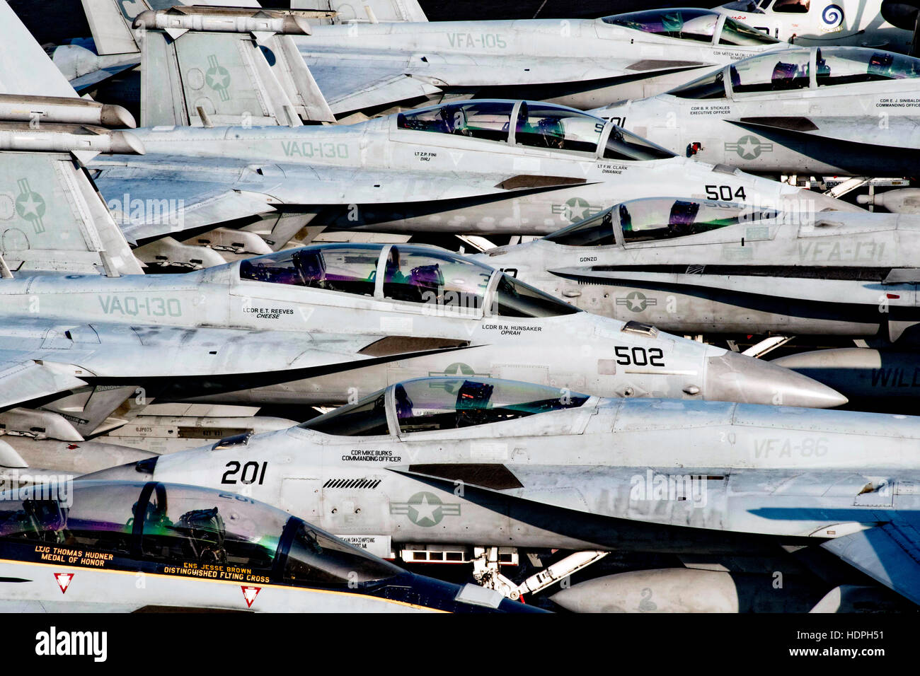Aircraft stand by on the flight deck aboard the USN Nimitz-class aircraft carrier USS Dwight D. Eisenhower November - Stock Image
