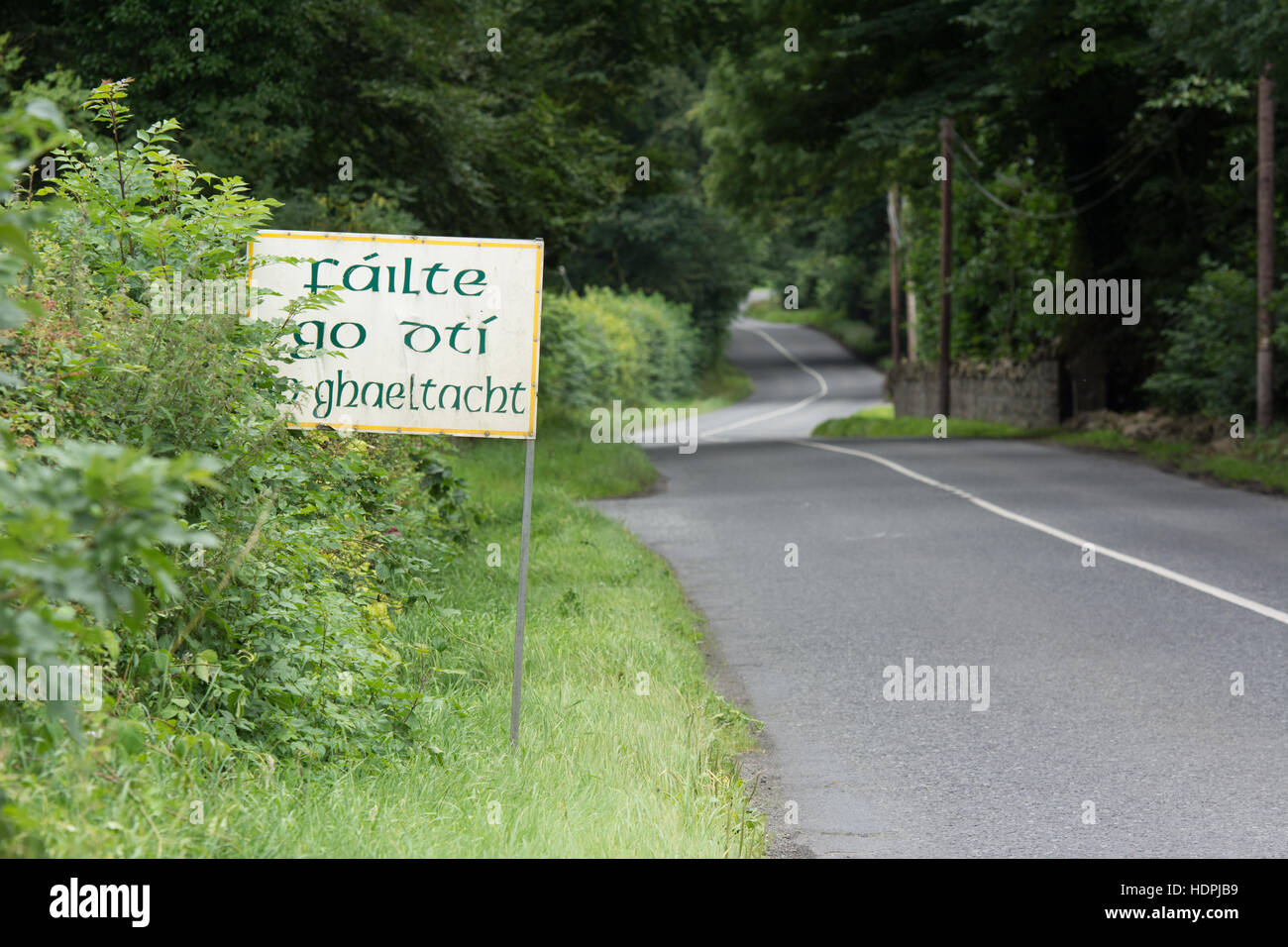 Sign in Irish language welcoming visitors to the gaeltacht (Irish-speaking) part of county Meath in Ireland. - Stock Image