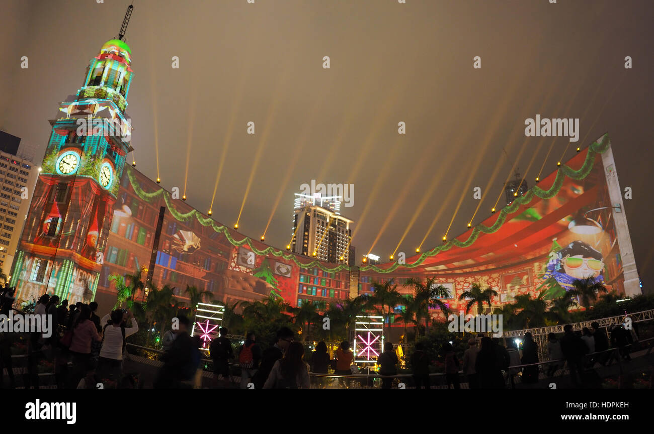 Wide angle panoramic view of the Hong Kong Pulse 3D light show display at night - Stock Image