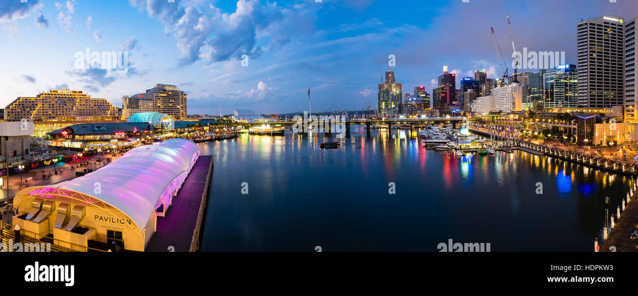 Iconic Sydney Darling Harbour purple night lights reflexion - Stock Image
