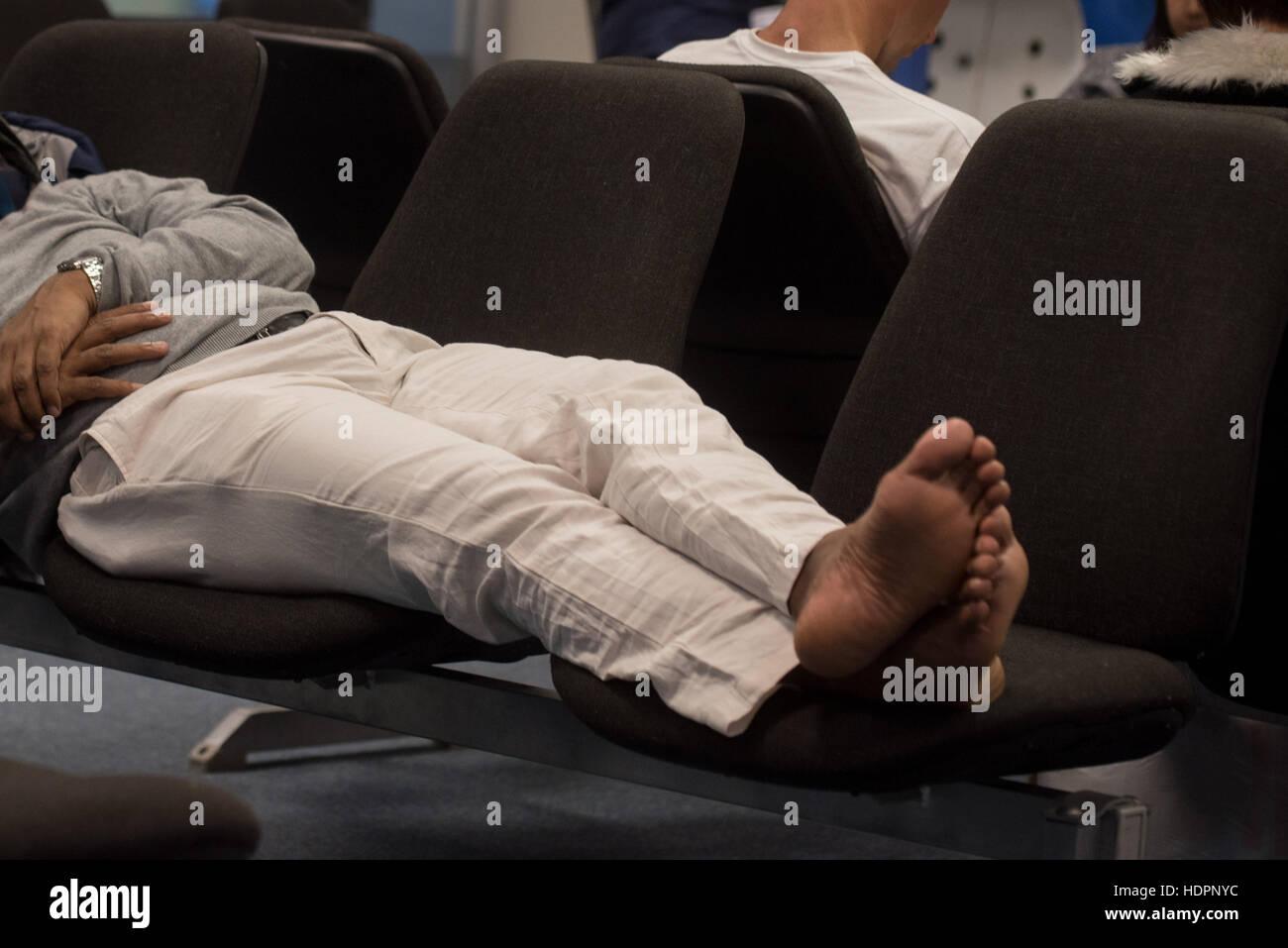 Man sleeps at airport Stock Photo
