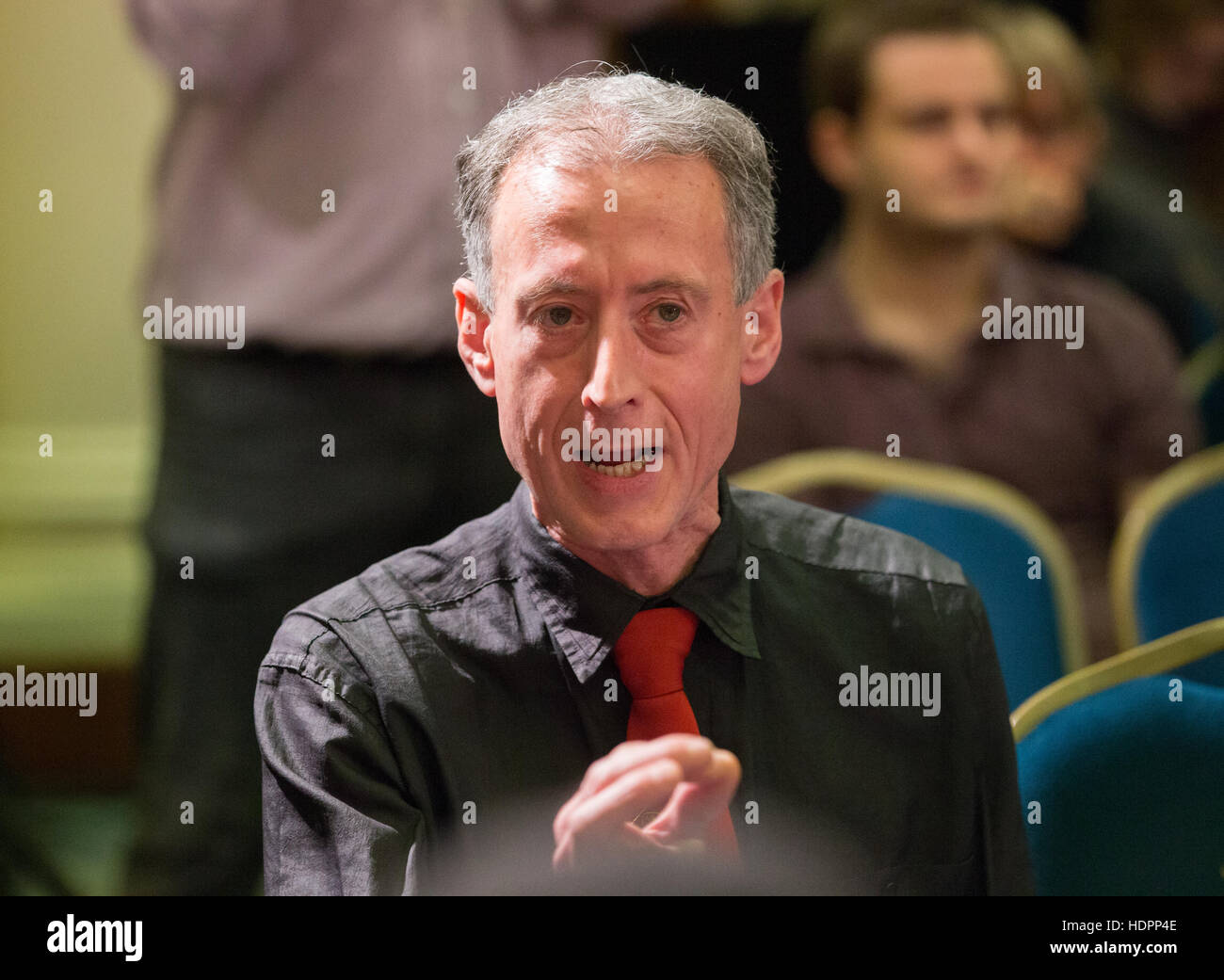 Human rights campaigner,Peter Tatchell,heckles Jeremy Corbyn,during his speech on Human Rights and demands air drops - Stock Image