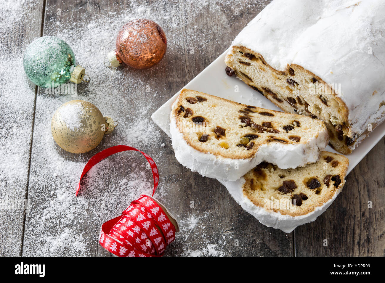 Christmas stollen. Traditional German Christmas dessert on wooden background - Stock Image