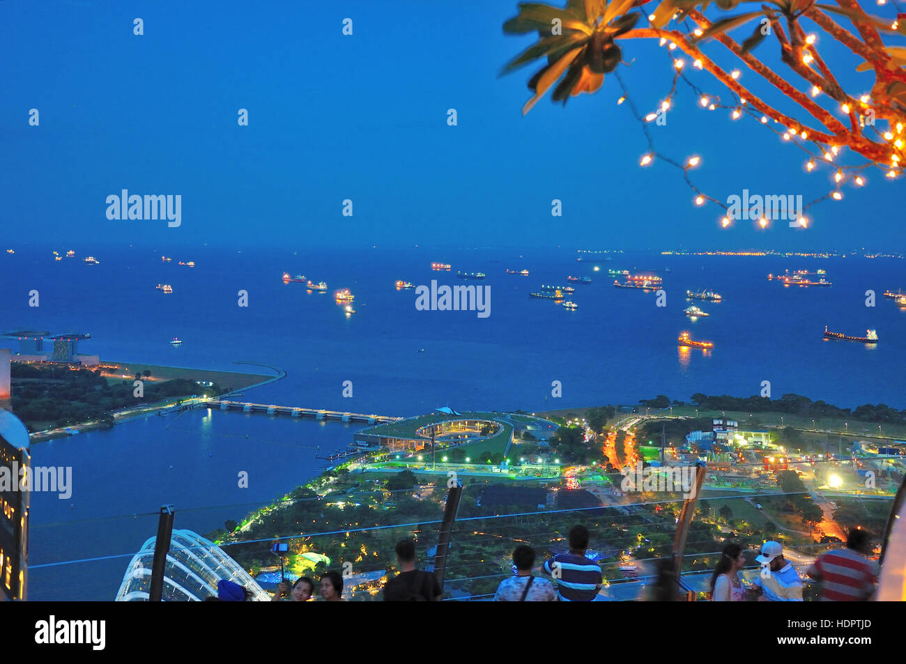 Aerial view from Sky Bar Singapore Marina Sands, looking at the Johore Strait between singapore and malasia - Stock Image