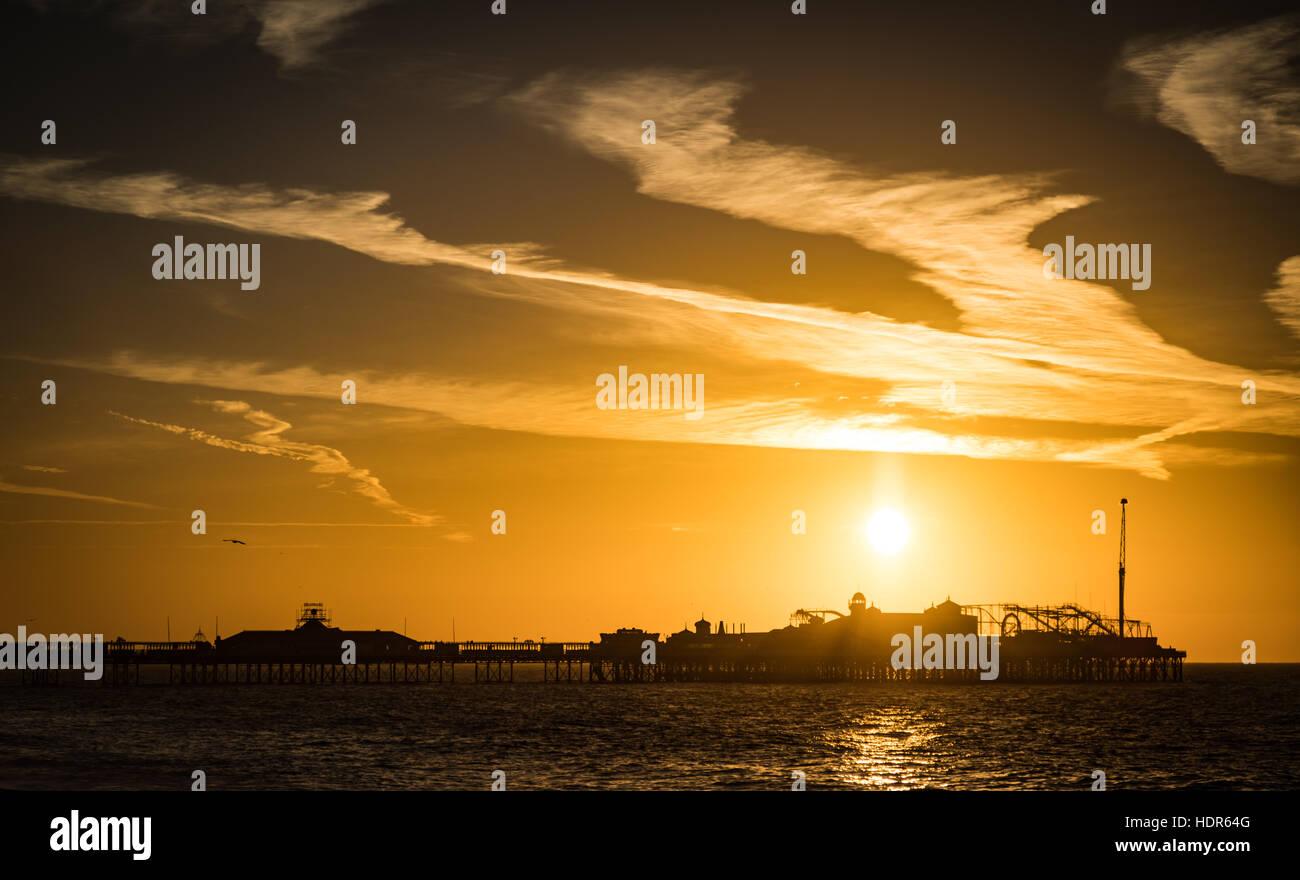 Sunrise over Palace Pier Brighton - Stock Image